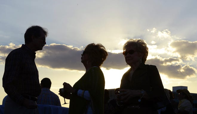 A scene from a previous Sunset Sips on Memorial Bridge on Broad Street; this year's edition of the annual fundraiser for Downtown Gadsden Inc. is Tuesday.