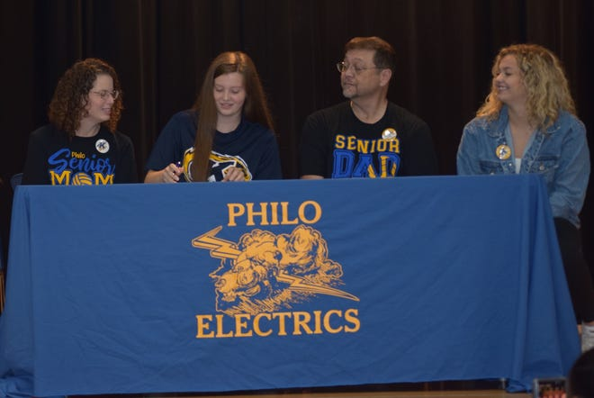 Signing a Letter of Intent is Nicole Simons (middle) sitting between her mother Lisa, father Dennis and sister Janelle.