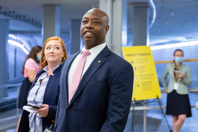 FILE - Sen. Tim Scott, R-S.C., speaks to reporters amid ongoing negotiations on the infrastructure bill on Capitol Hill in Washington, on Wednesday, Aug. 4, 2021. Scott didn't endorse a primary candidate in South Carolina's 2018 gubernatorial race, but for 2022, he's offering an early nod to incumbent Gov. Henry McMaster.  Next month, Scott is the special guest at a fundraiser for McMaster's reelection campaign, according to an invitation obtained by The Associated Press.  (AP Photo/Amanda Andrade-Rhoades, File)