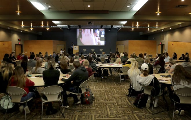 """UW-Oshkosh students watch the documentary """"Kids in Crisis: You're Not Alone"""" on Oct. 12 at the university's Reeve Memorial Union. The event was held in commemoration of World Mental Health and National Coming Out days, Oct. 10 and 11."""