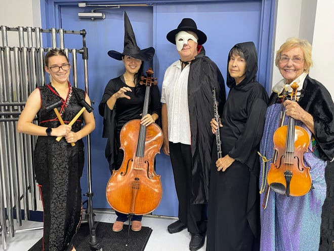 """Frightfully good musicians, from left, Kirstin Tyler, Angelica Ramirez, Maestro Mark Nelson, Jean Allan and Charlene Peacock, get in the spirit as the Melbourne Community Orchestra presents """"Ghoulies & Ghosties"""" on Oct. 27 and 28 at Melbourne Auditorium."""