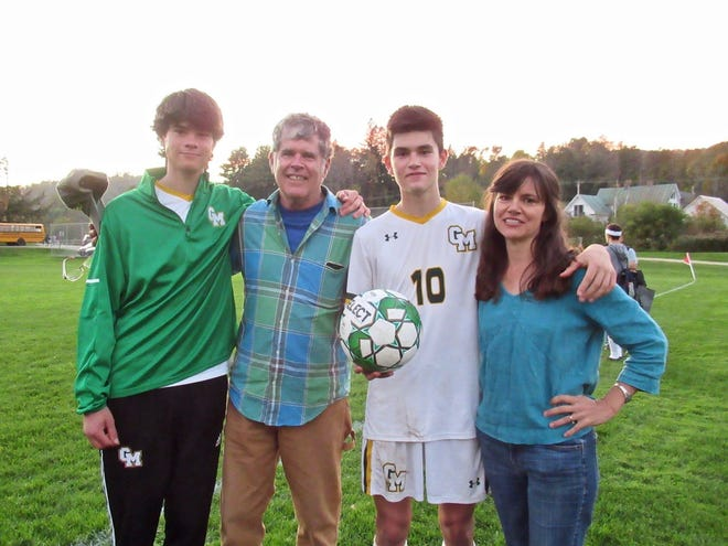 Green Mountain's Everett Mosher (No. 10) poses with family, brother Eben, and parents Brian and Amy after Everett Mosher scored his 100th career goal on Tuesday.