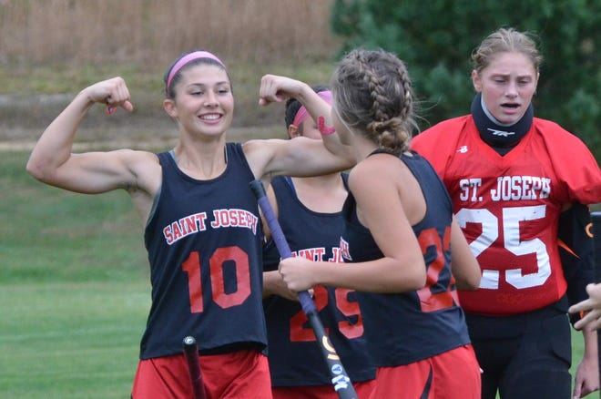 St. Joseph Academy junior Macie Jacquet explains to a teammate that the 'Sun's out'