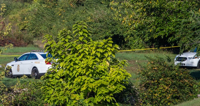 """Indianapolis Metropolitan Police department (IMPD) police continue on Wednesday, October 13, 2021, investigating three murders in """"a remote place"""" outside South Meridian Street near the I-465 pass."""