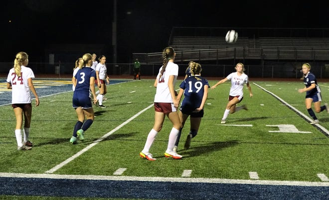 Players from Lancaster and Newark battle for the ball during their Ohio Capital Conference-Buckeye Division game Tuesday night at Fulton Field.  The Wildcats won their first ever OCC title with a 4-0 victory over the Lady Gales.
