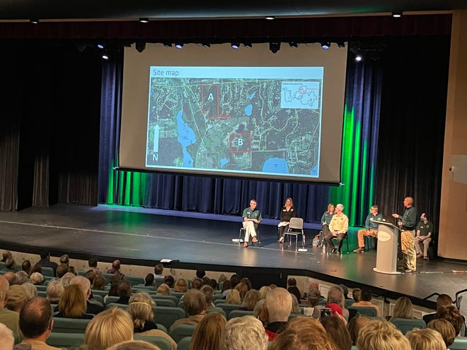Hundreds of people attended a Michigan Department of Natural Resources public meeting about a proposed tree seed orchard and plan to lease mineral rights for gravel or sand mining at Brighton High School, Tuesday, Oct. 12, 2021.