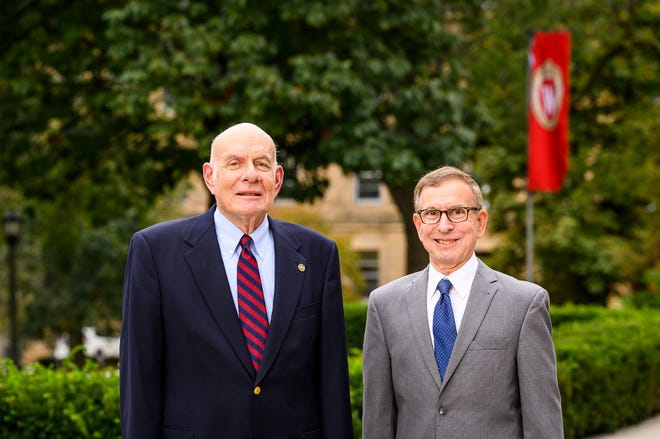 UW-Madison alumni and brothers Marv Levy '69, JD '71, at left, and Jeff Levy '72 are pictured on Bascom Hill at the University of Wisconsin-Madison during autumn on Oct. 12, 2021. The Levy brothers are donating a $20 million lead gift to help realize vision of a new UW-Madison College of Letters & Science academic building. Construction on the building, to be named Irving and Dorothy Levy Hall in honor of the brother's parents, is expected to begin in 2023. (Photo by Jeff Miller / UW-Madison)