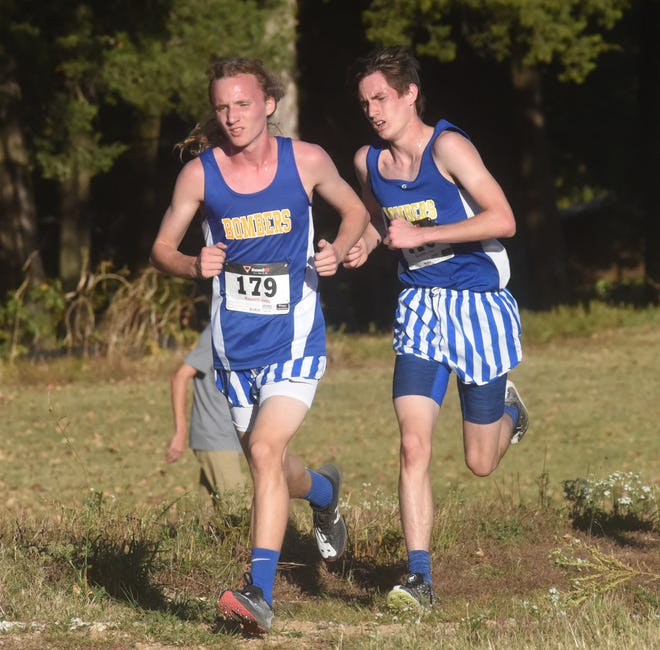 Mountain Home's Hendrix Hughes and Ky Bickford compete at last year's Bomber Invitational cross country meet. The Bombers' home meet has a new course this season at the ASUMH campus.