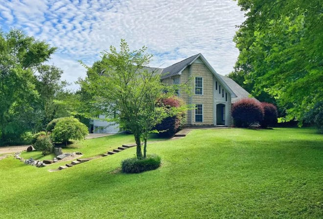 The house, pond, and 1.8 acres at 5510 Willow Bend Drive is for sale for $495,000. The home has five bedrooms and two full bathrooms along with four half baths. The layout includes a covered patio, porch, and fireplace.