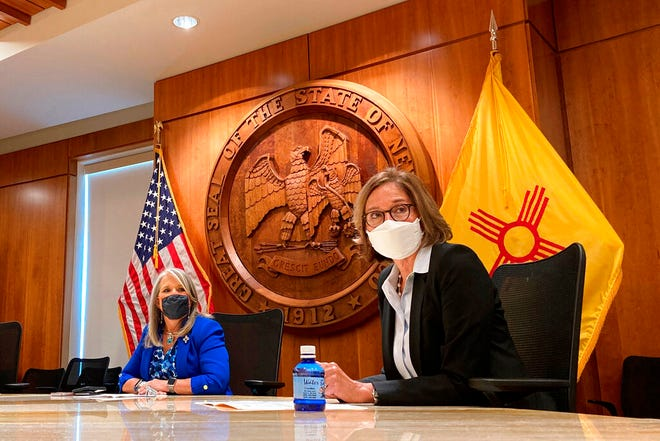 In this Aug. 10, 2021, file photo, recently retired state Supreme Court Justice Barbara J. Vigil, right, appears at a news conference in Santa Fe, N.M., as Gov. Michelle Lujan Grisham looks on.