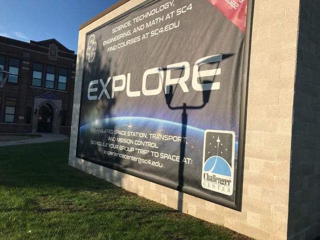 A poster promoting the Challenger Center, a space-themed learning experience, sits on St. Clair County Community College's campus. The center is set to open at the college in spring 2022.