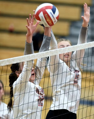 Rian Finley, left, blocks a Spanish Springs shot during Tuesday's game at Reno High School on Oct. 12, 2021. Reno won 3-0.