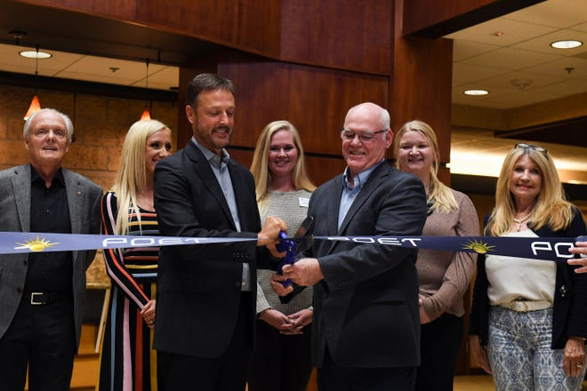 Jeff Broin, CEO, and Rod Pierson, general manager and vice president of POET Design and Construction, cut a ribbon to celebrate the completion of a solar field on Wednesday, October 13, 2021, at the Poet headquarters in Sioux Falls.