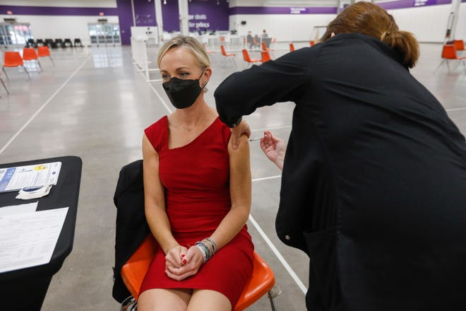 Katie Towns, Director of the Springfield-Greene County Health Department, receives a booster shot of the COVID-19 vaccine at the new vaccination clinic, located at 1425 E. Battlefield Rd., on Wednesday, Oct. 13, 2021.