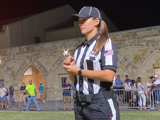 Rachel Stepien, officiating a recent Austin-area football game, made history in the summer by being part of the first all-female crew to officiate a high school game in Texas.