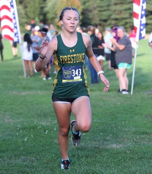Firestone's Freedom Stauffer runs to a first place finish in the Akron City Series Cross Country Championships at Goodyear Heights Metro Park Wednesday, Oct. 13, 2021 in Akron, Ohio.
