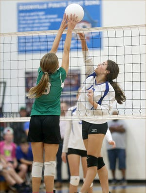 """LSE's Parker Johns goes up for a block in the second set against Ss. Peter & Paul's Isabella Imhoff Wednesday night during the """"Pink Out"""" game at the Windsor gymnasium at Boonville High School."""
