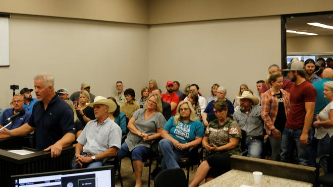 With a large audience behind him, Rusty Howell address the Brownwood City Council Tuesday morning.