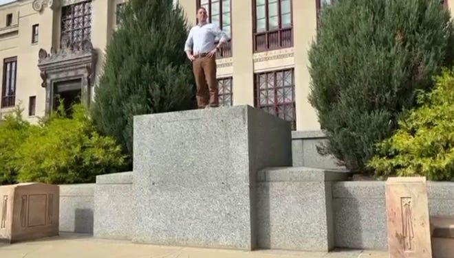 Josh Mandel seen imitating a statue outside of City Hall
