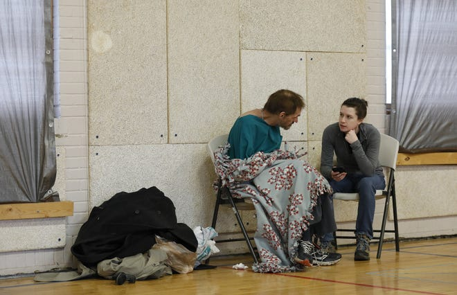 A Community Shelter Board staff member, right, speaks to a homeless Columbus resident during the board's annual city homeless count at a breakfast at the Columbus Dream Center, 38 West Greenwood Ave., in January 2020.