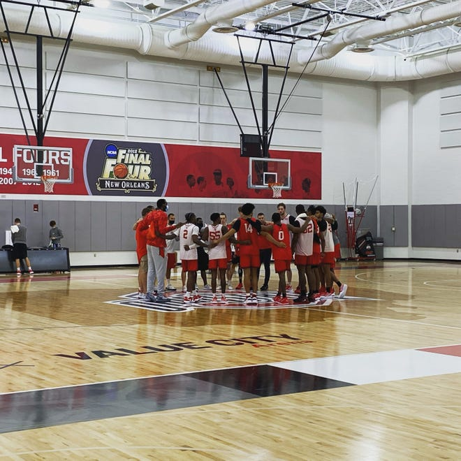 The Ohio State men's basketball team huddles up following practice inside Value City Arena on October 14, 2021.