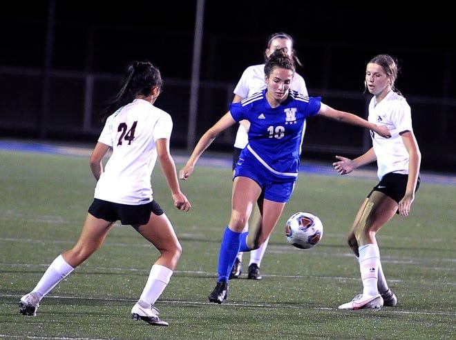 Wooster's Gabi Signorino splits a pair of defenders as she heads upfield. She scored twice in Wooster's win.