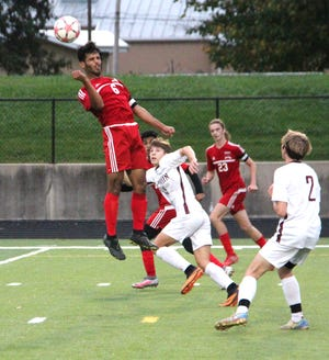 Coldwater leading scorer Amine Mohammed (6) uses his head to move the ball into the offensive zone versus Parma Western Wednesday. Mohammed had two goals in the Coldwater win