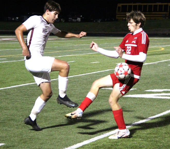 Coldwater's Brayden Boyd (22) goes toe-to-toe with a Parma defender late Wednesday. Boyd scored the Cardinals first goal of the game in the win
