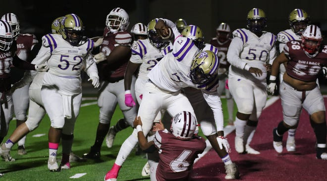 Ascension Catholic's J'Mond Tapp scores during the Bulldogs' 43-22 district win over White Castle.