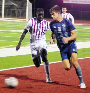 Bethel junior Muhammed Jammeh, left, and Oklahoma Wesleyan sophomore Luka Lukic battle for the ball during play Wednesday at Thresher Stadium. Second-ranked OWU claimed a 4-1 win over Bethel.