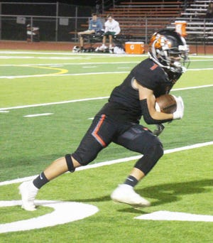 La Junta High School's Ethan Leyba runs with the ball on a reverse play in the Tigers' 60-27 win over Manitou Springs on Oct. 8. La Junta hosts 10th-ranked Bayfield on Oct. 16.