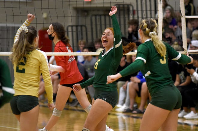 Colleen Castiglione of SMCC celebrates a point with Kyleigh Cobb and Kate Collingsworth against Milan in the Huron League volleyball tournament semifinals Wednesday.