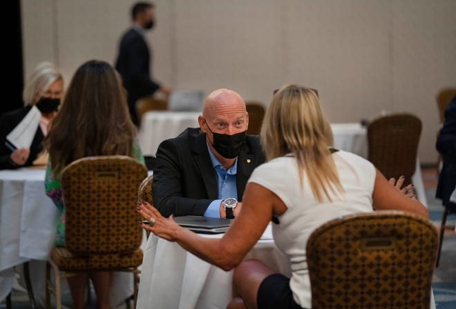 Director of Recreation, Andrew Huebner, interviews a person during a job fair at the The Boca Raton who is hiring 1,000 workers for the property's mid-December reopening. The hotel is finishing a $175 million renovation in  Boca Raton, Florida on October 14, 2021.
