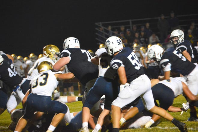 Sault High's Nick Cicco (71) and Chris Kiekhaefer (59) block on a running play up for John Robinson (5) during last week's game against TC St. Francis. Sault High visits Benzie Central this Friday.