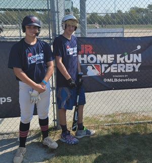 Newcomerstown's Gavin Smith (right) finished third in the MLB Junior Home Run Derby Midwest Regional competition held in Chicago recently. The 13-year-old Smith finished second in the first round of about 70 kids and advanced to the final four where he ended up finishing third overall going against kids as old as 15 at the time of the event. Smith started by winning a home run derby in Columbus to advance to the Midwest Regional. Smith goes to Newcomerstown Middle School and is in the 8th grade.