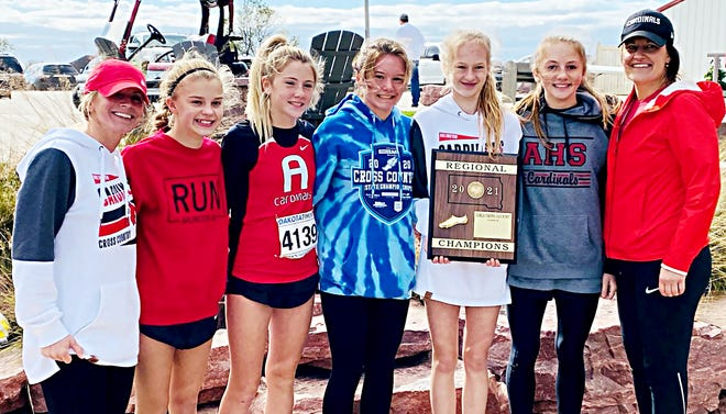 Arlington High School won the girls division championship on Wednesday in the Region 2B high school cross country meet at the Rocky Run Golf Course in Dell Rapids. Team members include, from left, head coach Jeani Vincent, Madalyn Madsen, Isabelle Steffensen, Ellisyn Vincent, Kaelyn Ulschmid, Halley Miller and assistant coach Michelle Madsen.