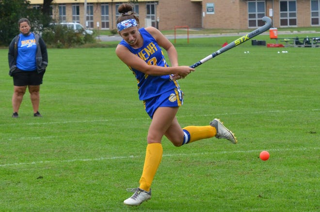 Buena senior Madison Hand fires a shot during warmup with coach Maryann Busan looking on