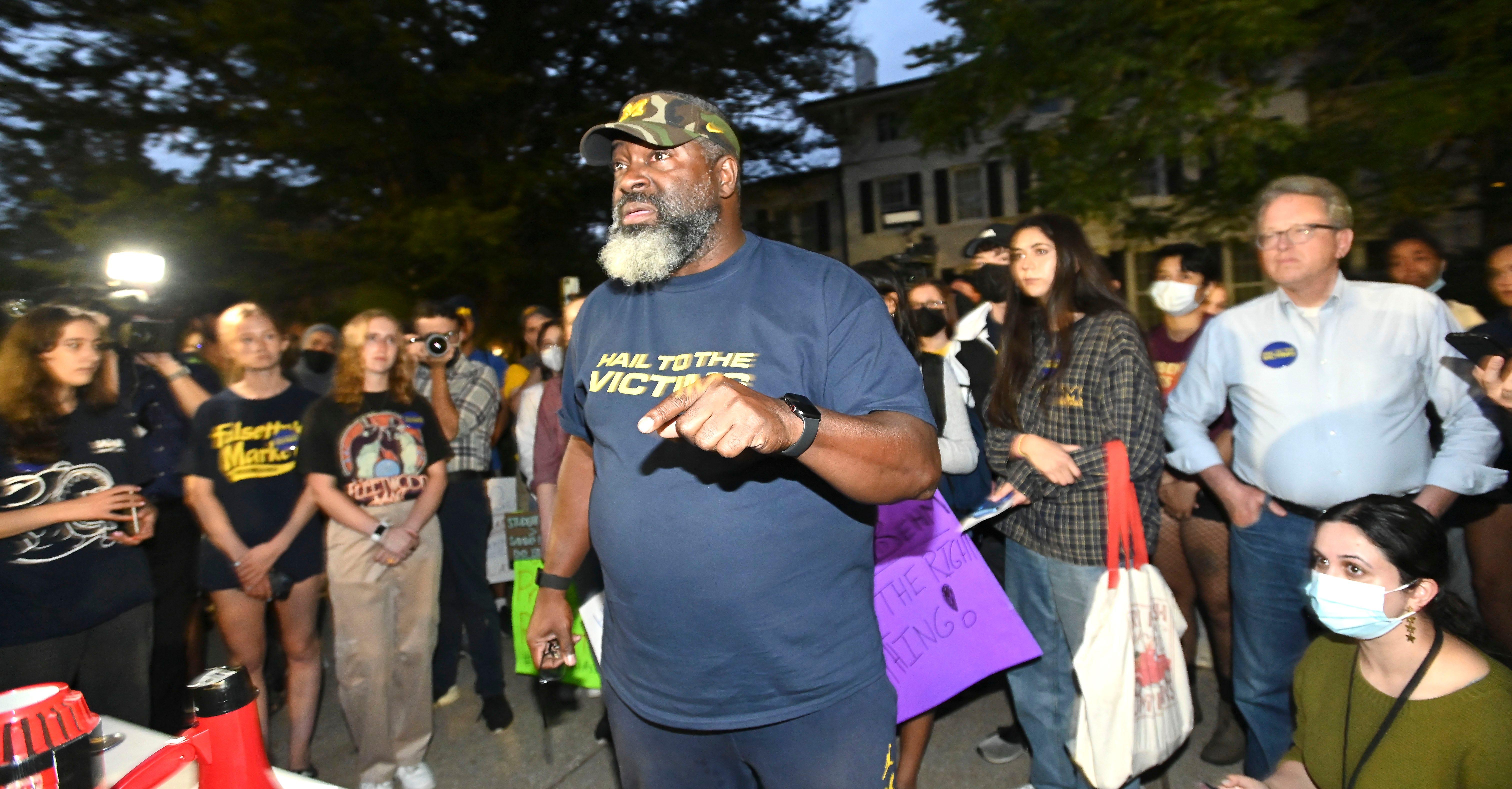 Nassar survivors, students join protest outside UM president's home