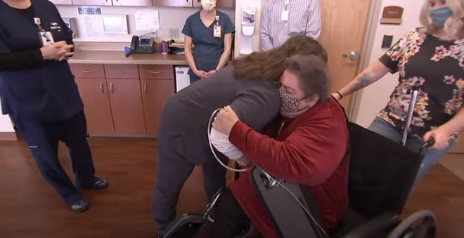 """Staff at SSM Health St. Agnes Hospital in Fond du Lac welcome back Gloria Schmeling during a special reunion with team members who cared for her when she was extremely ill during the COVID-19 pandemic. Schmeling is featured in the documentary """"Behind the Mask.'"""