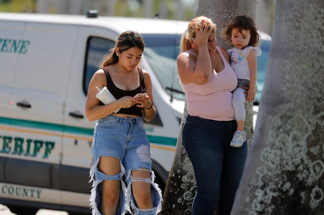 Milagros Chirinos, of Naples, wipes her tears after speaking with Lee County Sheriff's deputies at Gulf Coast Town Center Thursday, Oct. 14, 2021. Chirinos along with her daughter and daughter in law reported being victims of a carjacking which started on I-75 after she had pulled over to feed her daughter.