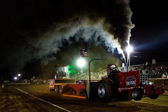 Diesel exhaust fills the air as The Boss, driven by Tom Shafer, of Glenford, Ohio, pulls the sled down the track during the Light Limited Pro Tractor Class during the truck and tractor pull in front of the grandstand at the Fairfield County Fair in Lancaster, Ohio on October 13, 2021. To view more photos visit www.lancastereaglegazette.com.