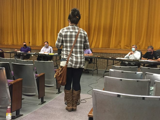 A parent addresses the Lexington Local Schools Board of Education at Wednesday night's meeting.