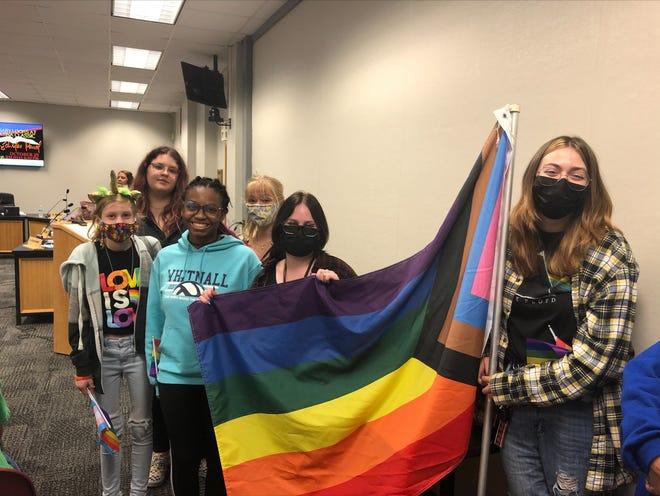 Autumn Gilligan, Gigi Mickschl, Kayla Kohn, Desi Levenhagen, Allyson Kulinski and Miah Miner holding a flag during Wednesday's meeting