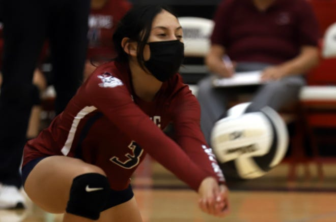 Senior Lady 'Cats Belen Carrilo dips down for a dig on Tuesday.