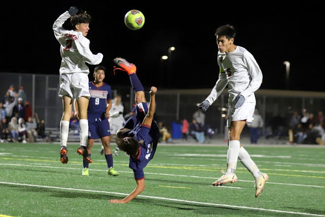Junior Wildcat midfielder Jan Carlo Cisneros attempted this bicycle kick in front of the Centennial High goal late in the second half of a 0-0 tie. After two overtime periods, the match ended in a scoreless deadlock.