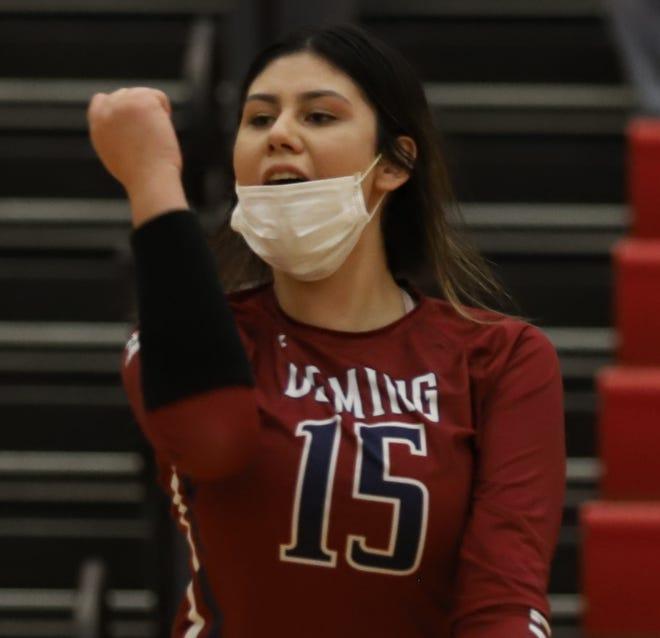 Senior Lady 'Cat Maria Gomez celebrates one of team-leading 8 kills on Tuesday.