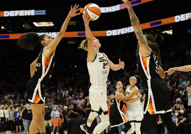 Oct 13, 2021; Phoenix, Arizona, USA; Chicago Sky guard Courtney Vandersloot (22) makes a basket that sent the game into overtime against the Phoenix Mercury during game two of the WNBA Finals.