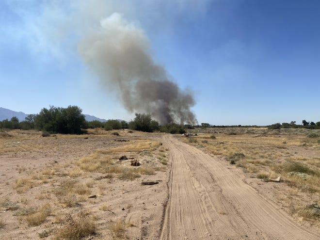 A brush fire closed 91st Avenue and burned at least eight acres on Oct. 13, 2021.