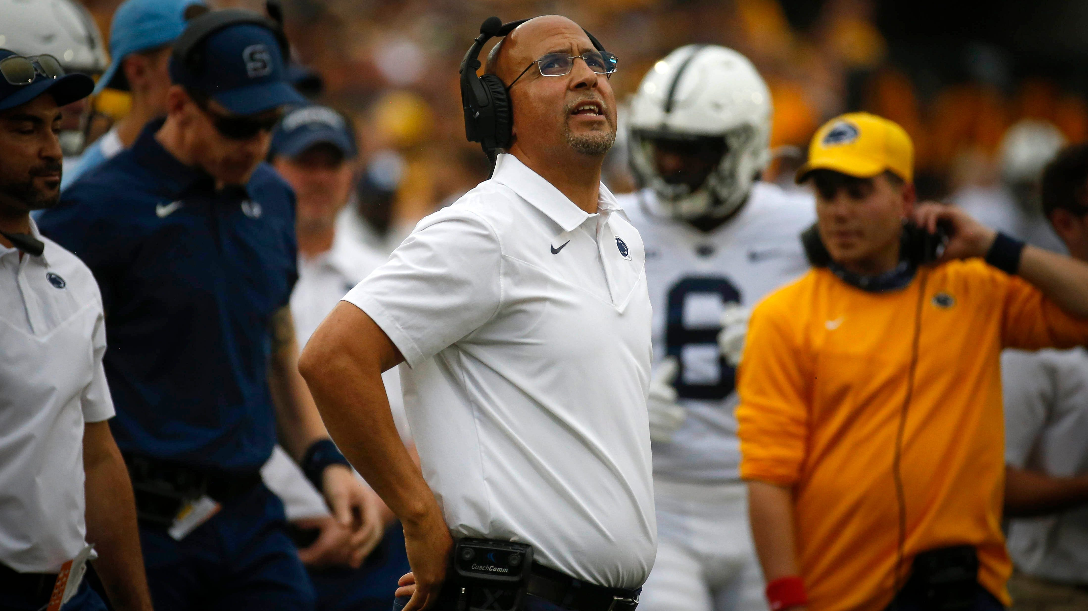 Penn State head football coach James Franklin looks up at the big screen after a play in the third quarter against Iowa.