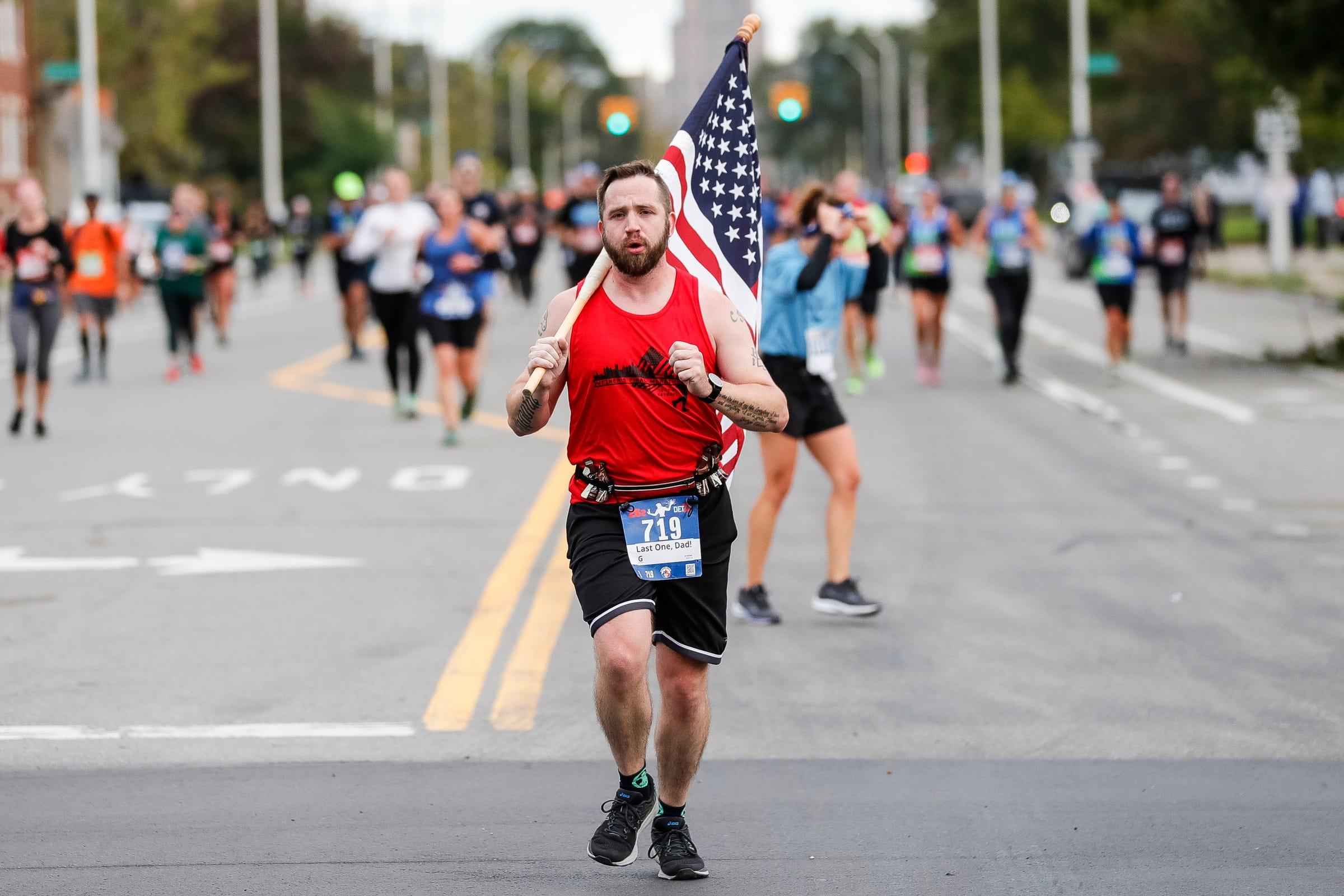 2021 Detroit Free Press Marathon: Army veteran carries flag all 26.2 miles for final race